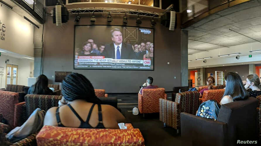 Students watch the hearing of U.S. Supreme Court nominee Brett Kavanaugh at the Walter Cronkite School of Journalism and Mass Communication at Arizona State University, Phoenix, Sept. 27, 2018, in this picture obtained from social media.