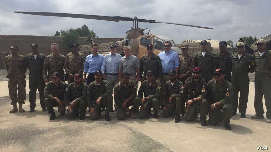 Members of a U.S. congressional delegation, headed by Republican Senator John McCain, pose for a picture with Dragon helicopter pilots from the Pakistani Air Force in Miramshah, North Waziristan, Pakistan, July 3, 2016. (@SenJohnMcCain)