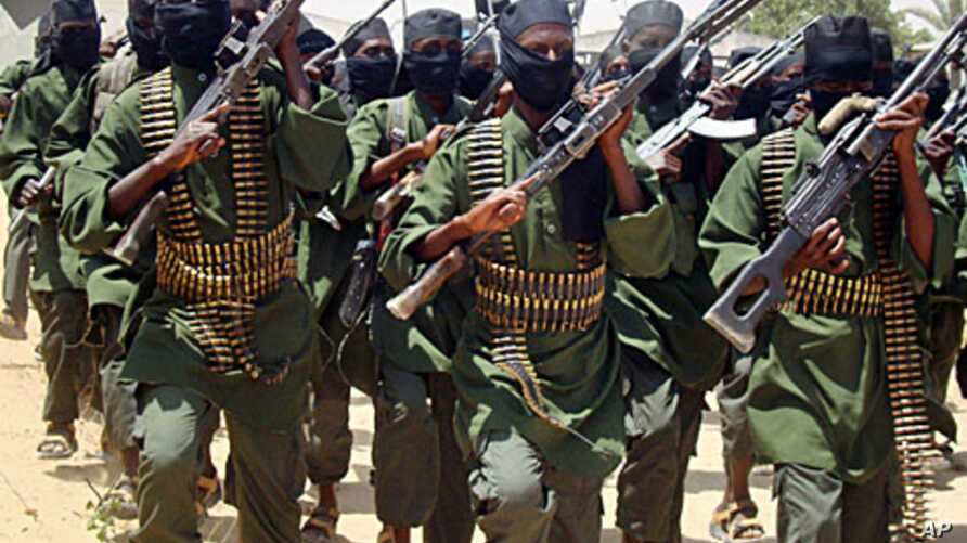Al-Shabab fighters march with their guns during military exercises on the outskirts of Mogadishu (File)