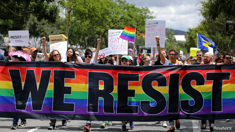 The annual Pride Parade is replaced with a Resist March as members of the LGBT community protest President Donald Trump in West Hollywood, California, June 11, 2017.