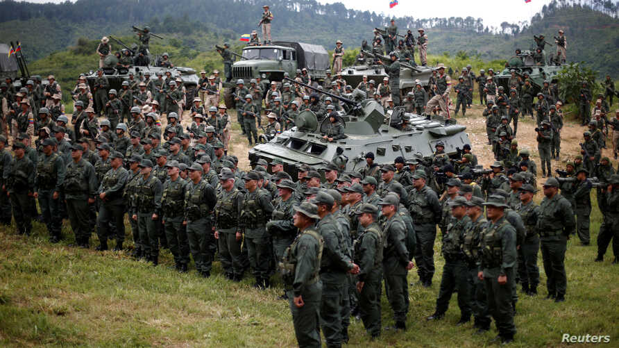Members of the National Bolivarian Armed Forces attend a news conference of Venezuela's Defense Minister Vladimir Padrino Lopez in Caracas, Venezuela, Aug. 14, 2017.