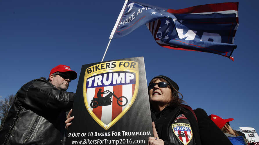 Supporters of President Donald Trump, Katie Miller, right, and her husband, Mark Miller, from Boonsboro, Md., join a rally at the National Mall in Washington, organized by the North Carolina-based group Gays for Trump, March 4, 2017.