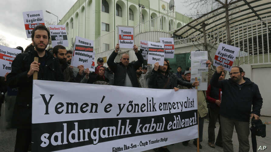 "Pro-Islamic Turks hold a banner that reads ""Imperialist aggression against Yemen cannot be accepted"" as they protest against the Saudi Arabia-led coalition's military operation in Yemen, in Ankara, Turkey, March 29, 2015."