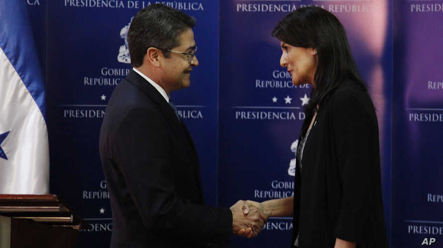 Honduran President Juan Orlando Hernandez shakes hands with Nikki Haley, U.S. ambassador to the United Nations, in Tegucigalpa, Honduras, Feb. 27, 2018. Haley said Hernandez should increase efforts to establish a dialogue with opposition leaders who