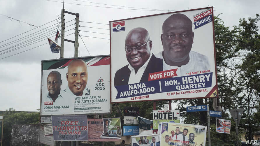 The campaign billboards of Ghana's two main political parties running in this year's national election are shown in the streets of Accra in Ghana, Oct. 8, 2016.
