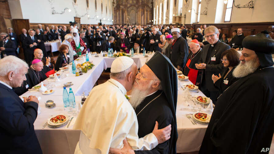 Pope Francis hugs Orthodox Ecumenical Patriarch Bartholomew I, during a day of prayer for peace, in Assisi, Italy, Sept. 20, 2016.