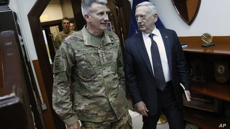 U.S. Defense Secretary James Mattis, right, and U.S. Army General John Nicholson, left, commander of U.S. Forces Afghanistan, arrive to meet with an Afghan defense delegation at Resolute Support headquarters, in Kabul Afghanistan, April 24, 2017. Mat