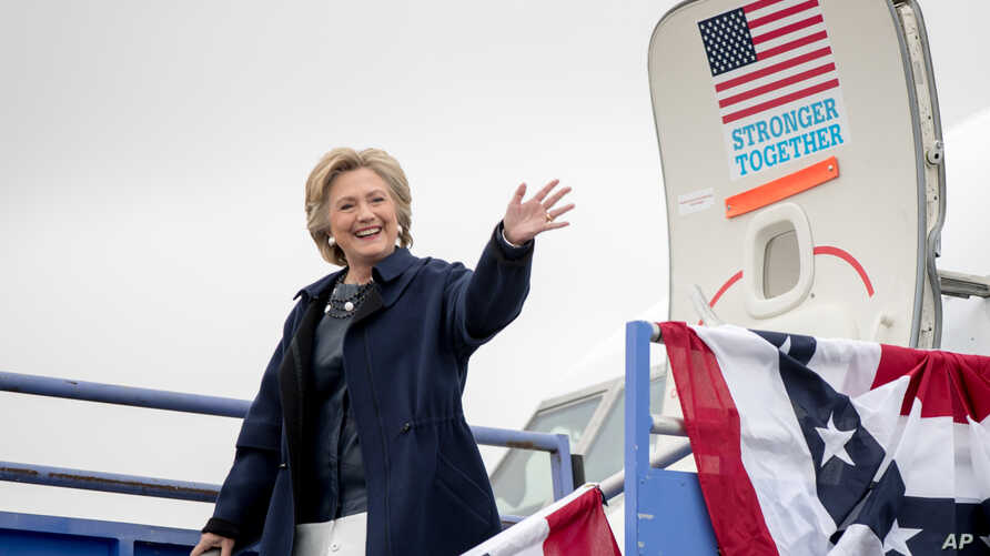 Democratic presidential candidate Hillary Clinton arrives at Pueblo Memorial Airport in Pueblo, Colo., Oct. 12, 2016, to attend a rally.
