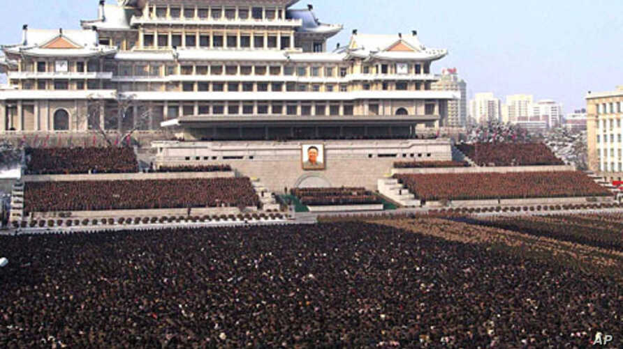 Photo released by the Korean Central News Agency and distributed in Tokyo by the Korea News Service, thousands take part in a national memorial service for late North Korean leader Kim Jong Il in Pyongyang, December 29, 2011.