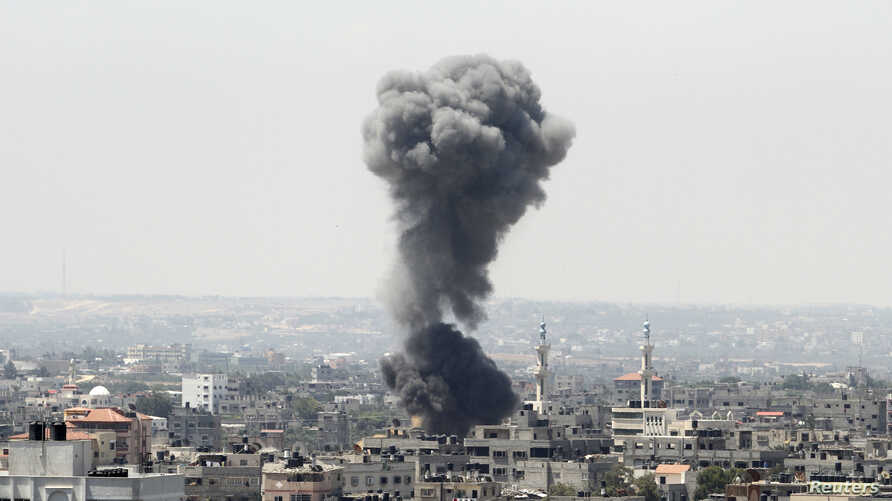Smoke rises following what witnesses said was an Israeli air strike in Gaza City July 8, 2014.