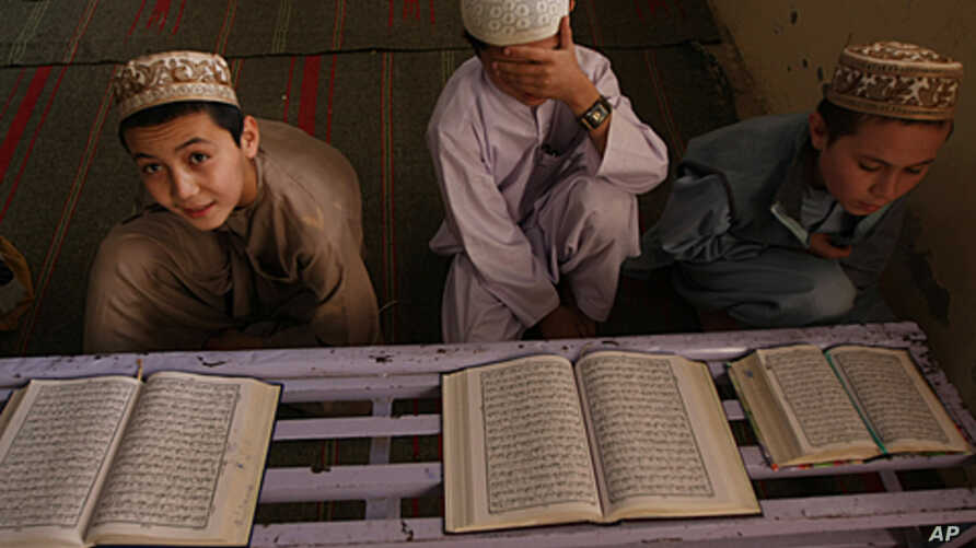 Pakistani religious students read Muslim's holy book the Quran, at a local madarassa or religious school in Karachi, Pakistan, March 6, 2010.