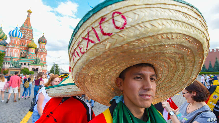 A Mexico fan walks at the Red Square in Moscow during the Russia 2018 World Cup football tournament on June 21, 2018.