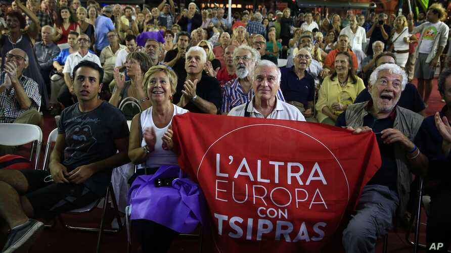 Supporters of left-wing Syriza party react as they watch the election results at the party's main electoral center in Athens, Sunday, Sept. 20, 2015.