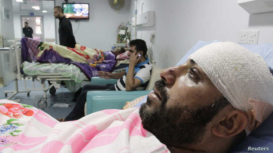 Shi'ite volunteers with the Iraqi Army, lie in hospital beds after being wounded in clashes with militants of the Islamic state, formerly known as the Islamic state in Iraqi and the Levant (ISIL), in Basra, southeast of Baghdad, Iraq, Aug. 6, 2014.