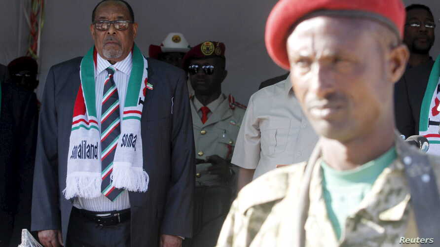 President Ahmed Mohamed Silanyo stands to salute troops during a street parade to celebrate  independence day for the breakaway Somaliland nation from Somalia in capital Hargeysa, May 18, 2015.