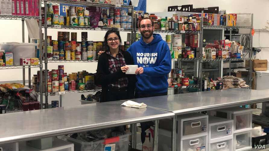 David Joffee from Nourish Now poses with Bella Berrellez. Nourish Now is a nonprofit organization that collects food from donors like restaurants and cafeterias and distributes it to families in need.