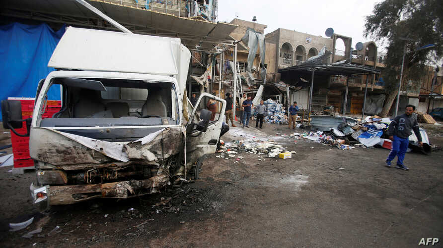 People gather at the site of car bomb attack in the Amil neighborhood in Baghdad, Iraq, March 21, 2017.