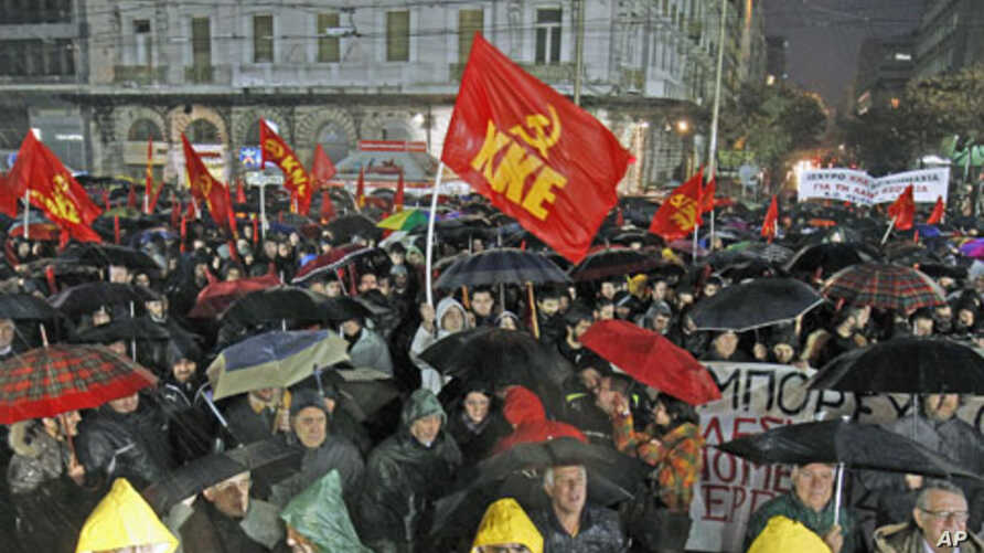 Demonstrators take part in a protest rally of the Greek Communist party against new austerity measures during heavy rainfall, in Athens, Greece, February 6, 2012.