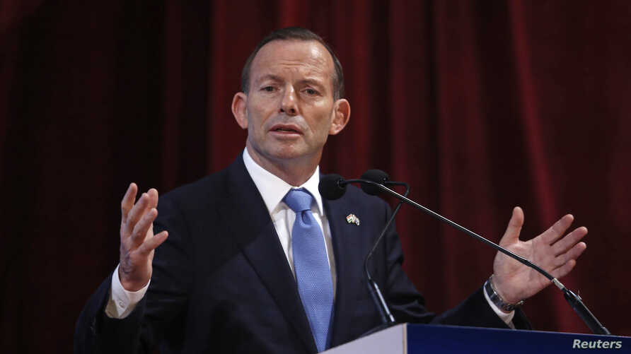 Australian Prime Minister Tony Abbott speaks during the launch of a student mobility program at a university in Mumbai, Sept. 4, 2014.