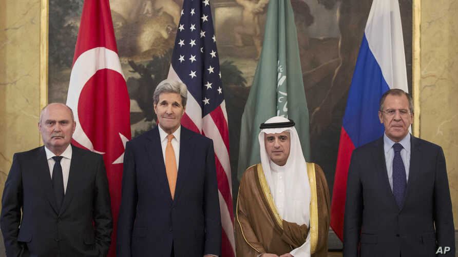 From left, Turkey's Minister of Foreign Affairs, Feridun Sinirlioglu,  U.S. Secretary of State John Kerry,  Saudi Arabia's  Minister of Foreign Affairs Arabia Adel al-Jubeir and Russia's Foreign Minister Sergey Lavrov during a meeting in Vienna, Oct.