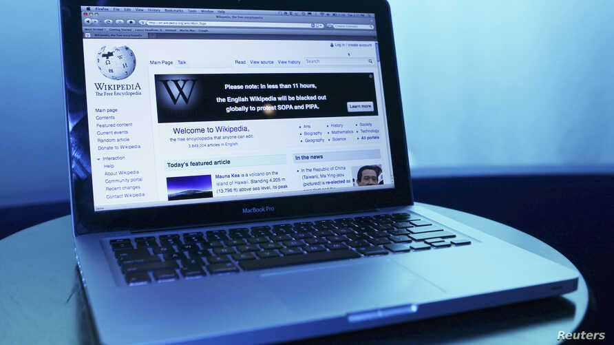 FILE - Wikipedia webpage in use on a laptop computer is seen in this photo illustration taken in Washington, January 17, 2012.