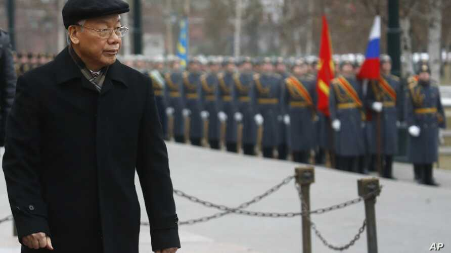 FILE - Vietnamese Communist Party General Secretary Nguyen Phu Trong attends a wreath-laying ceremony at the Tomb of the Unknown Soldier in Moscow, Nov. 24, 2014.