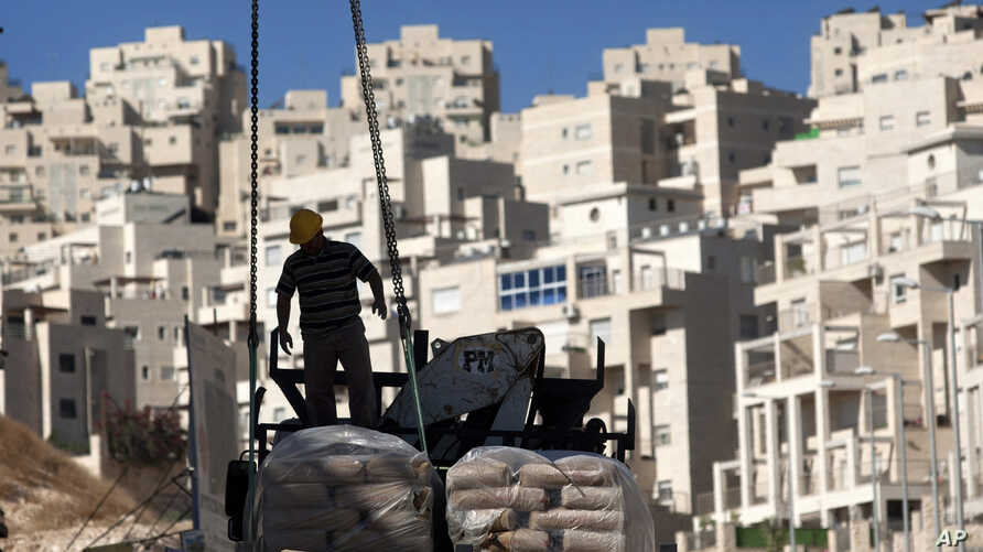 A construction worker works on a new housing unit in the east Jerusalem neighborhood of Har Homa. (File)