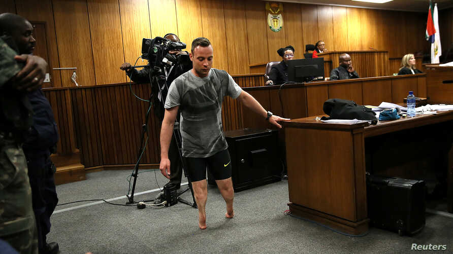 Paralympic gold medalist Oscar Pistorius walks across the courtroom without his prosthetic legs during the third day of his resentencing hearing for the 2013 murder of his girlfriend Reeva Steenkamp in the North Gauteng High Court in Pretoria, June 1