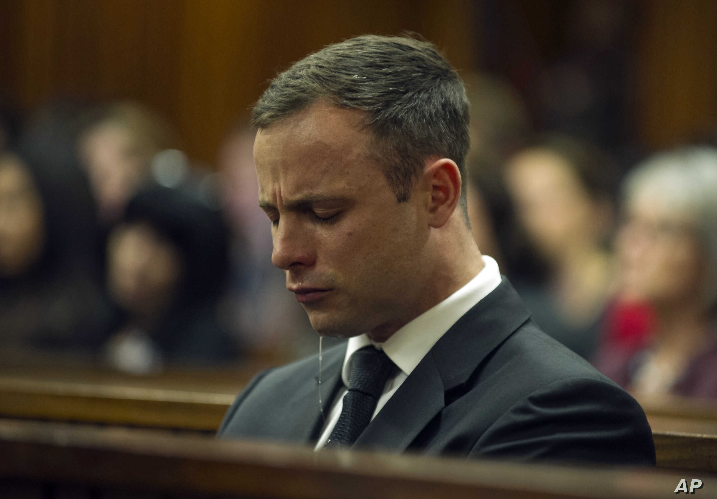 Oscar Pistorius cries in court in Pretoria, South Africa, Oct. 17, 2014 during the last day of sentencing procedures where the defense and prosecution will put their case for and against sentencing.