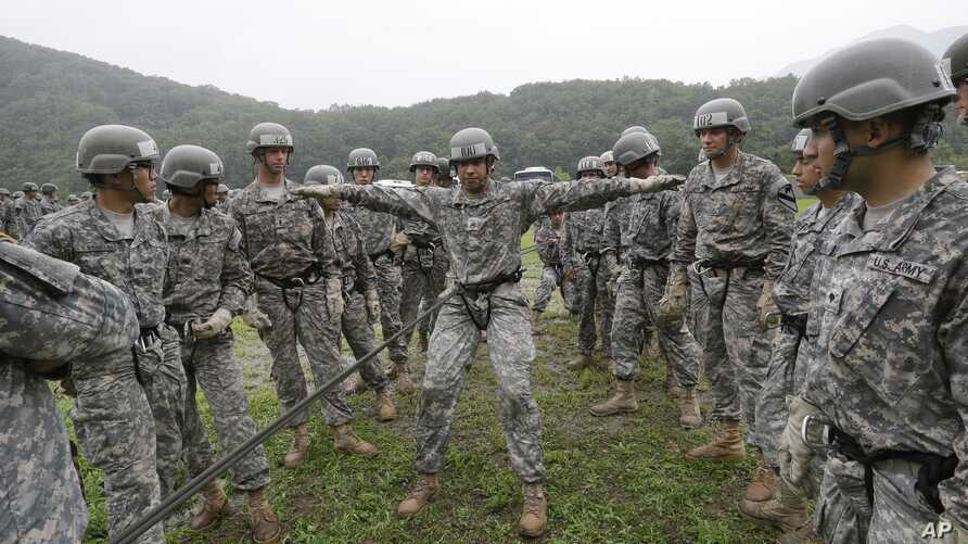United States Forces Korea 2nd Infantry Division soldiers take part in an air assault training session at Camp Casey in Dongducheon, South Korea, Friday, July 24, 2015.