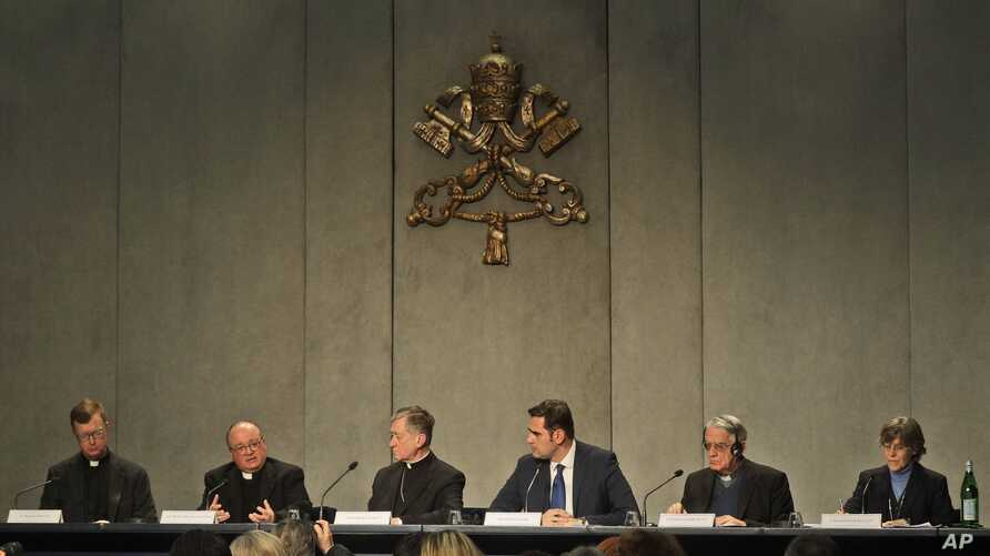 From left, Rev. Hans Zollner, Mons. Charles Scicluna, Cardinal Blase J. Cupich, Vatican Spokesperson Alessandro Gisotti, Rev. Federico Lombardi and Sister Bernadette Reis give a press conference on a Vatican summit on preventing clergy sex abuse, at ...
