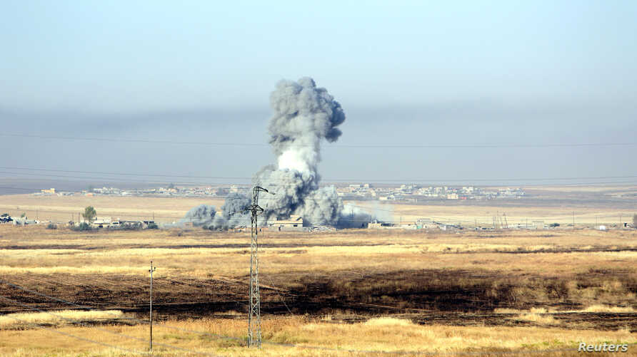 Smoke rises after airstrikes from the U.S.-led coalition against Islamic State militants in a village east of Mosul, Iraq, May 29, 2016.