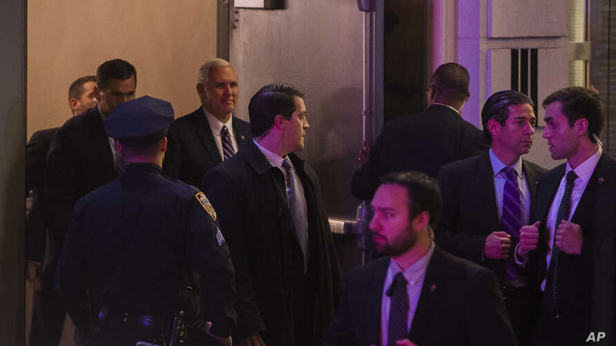 """Vice President-elect Mike Pence, top center, leaves the Richard Rodgers Theatre after a performance of """"Hamilton,"""" in New York, Friday, Nov. 18, 2016."""