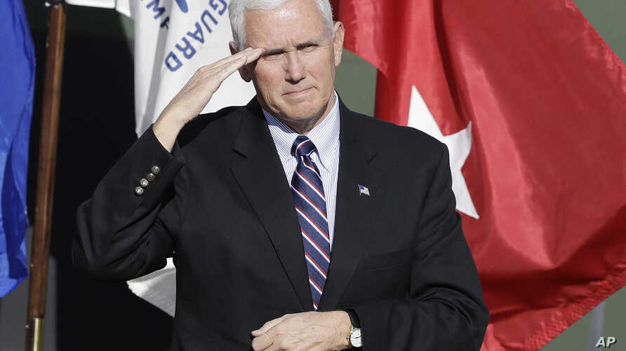 Vice President-elect Mike Pence salutes veterans during a Veterans Day ceremony at Camp Atterbury in Edinburgh, Indiana, Nov. 11, 2016.