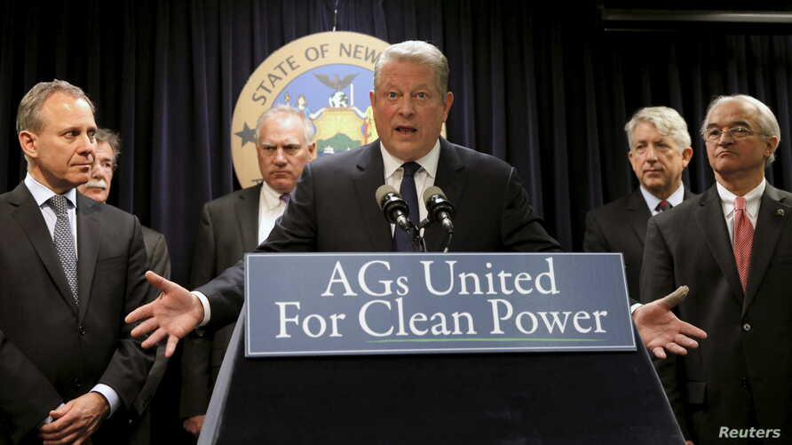 Former U.S. Vice President Al Gore speaks at a news conference with New York Attorney General Eric Schneiderman (L), Vermont Attorney General William Sorrell (R) and other U.S. State Attorney's General to announce a state-based effort to combat clima