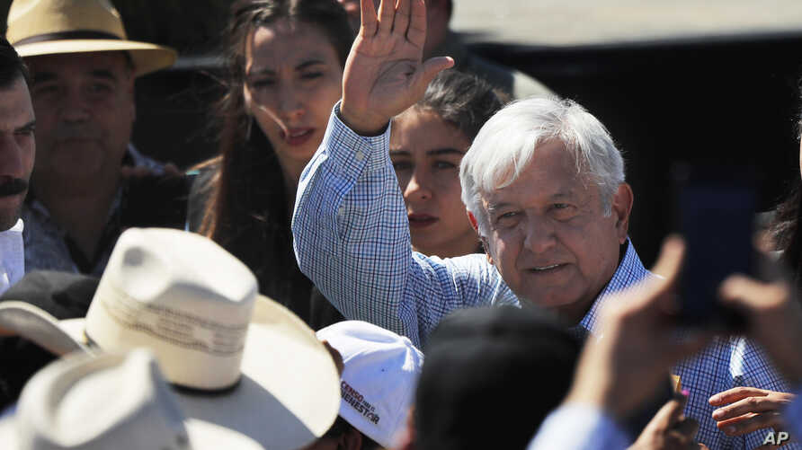 Mexican President Andres Manuel Lopez Obrador waves as he arrives for a meeting with dairy farmers in La Chona de Encarnacion de Diaz, Jalisco, Mexico, March 9, 2019.