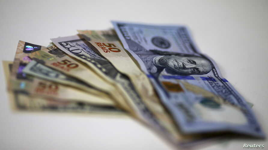 Brazilian Real and U.S. dollar notes are pictured at a currency exchange office in Rio de Janeiro, Brazil, in this Sept. 10, 2015 photo illustration.