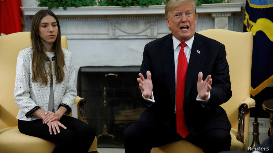 U.S. President Donald Trump meets with Fabiana Rosales, wife of Venezuelan opposition leader Juan Guaido at the White House in Washington, March 27, 2019.