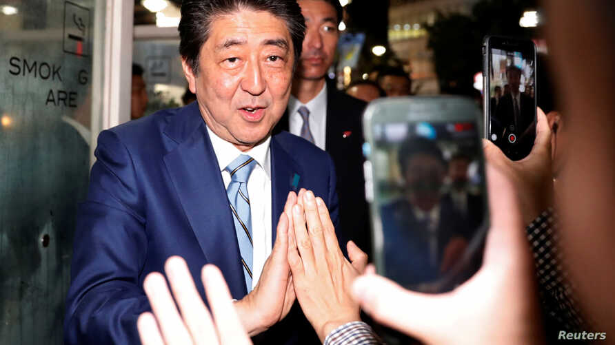 Japan's Prime Minister Shinzo Abe, leader of the Liberal Democratic Party, greets his supporters after making a speech at an election campaign rally in Tokyo, Japan, Oct. 20, 2017.