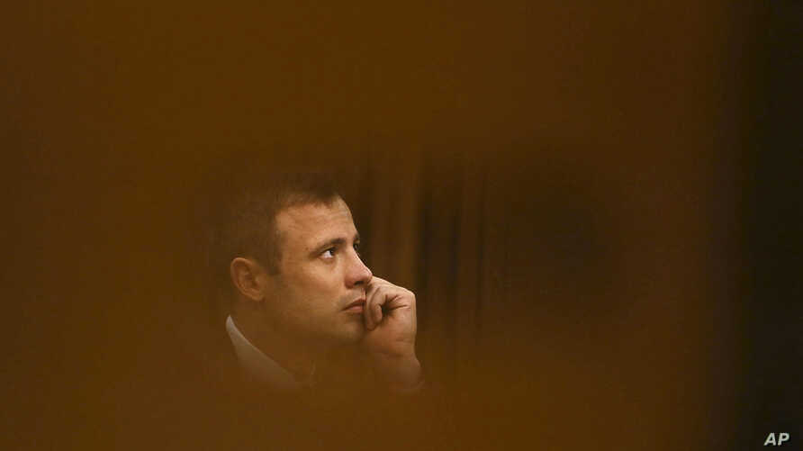 File - Oscar Pistorius sits in the high court for the fourth day of sentencing in Pretoria, South Africa, October 2014.