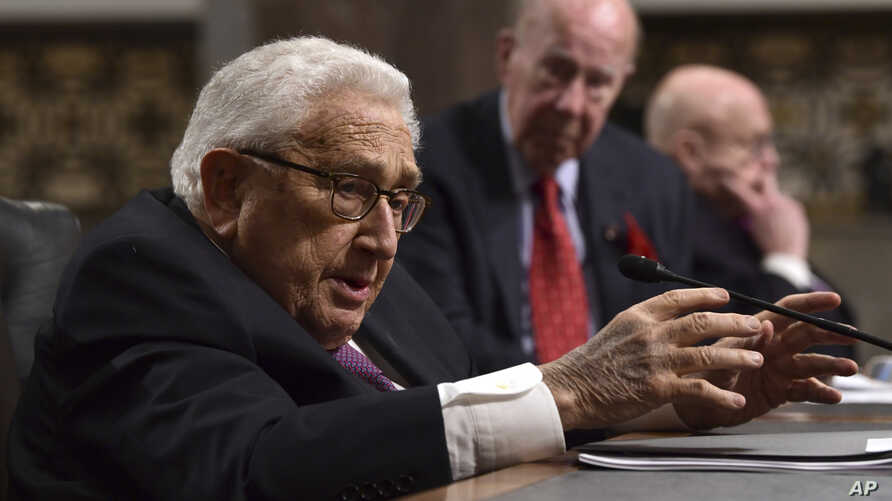 Former Secretary of State Henry Kissinger (L) speaks during the Senate Armed Services Committee hearing on Capitol Hill in Washington, Jan. 25, 2018, on global challenges and U.S. national security strategy.