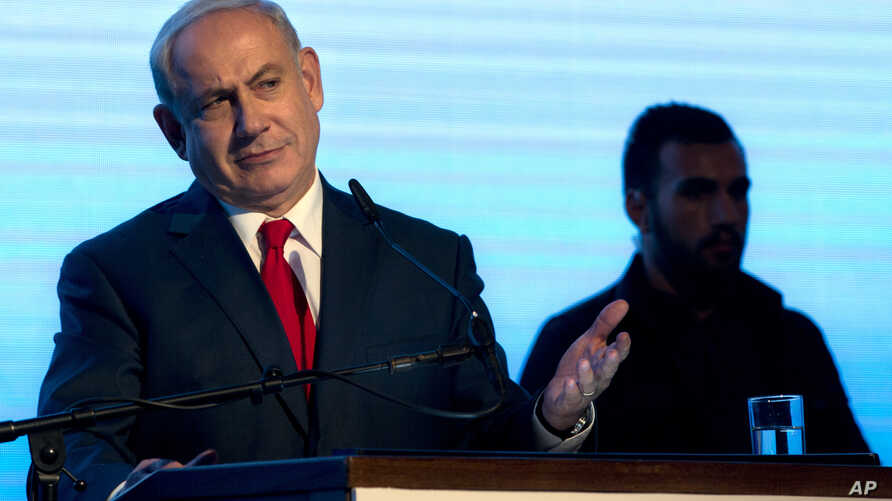 Israeli Prime Minister Benjamin Netanyahu gestures during a rally of his Likud party supporters, near Tel Aviv, Israel, Aug. 30, 2017.