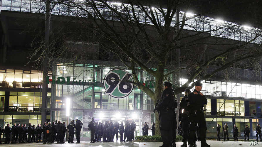 Police officers stand outside the HDI-Arena stadium as the soccer friendly match between Germany and the Netherlands was cancelled in Hannover, Germany, Nov. 17, 2015.