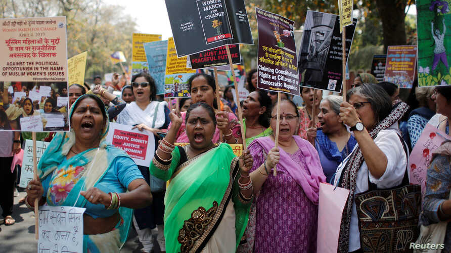 Women shout slogans as they hold during a protest march demanding to vote and reject the current environment of hate and violence in the country, in New Delhi, India, April 4, 2019.