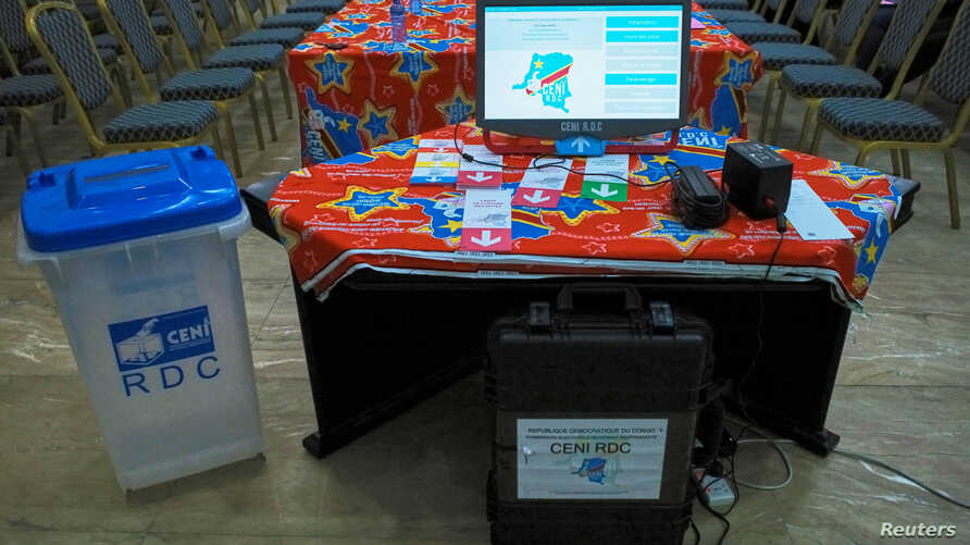 FILE - An electronic voting machine and a ballot box are seen inside the Congo's electoral commission (CENI) head offices at the Gombe Municipality in Kinshasa, Democratic Republic of Congo, March 1, 2018.