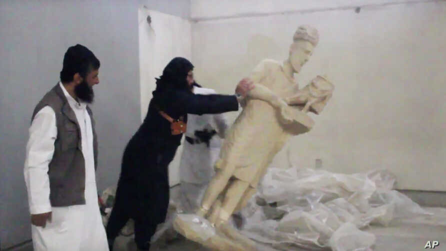 A five-minute video from the Islamic State group purports to show militants destroying ancient artifacts in Iraq's Mosul Museum. It was released Feb. 26, 2015.
