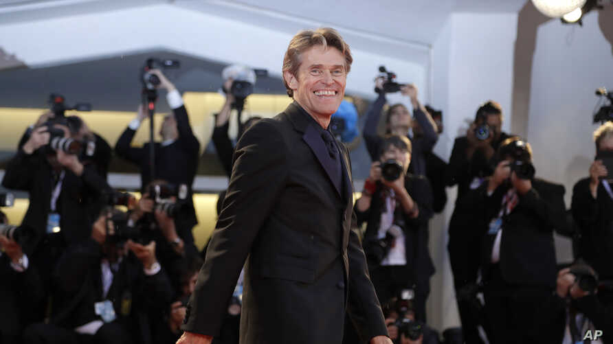 """Actor Willem Dafoe poses for photographers upon arrival at the premiere of the film """"At Eternity's Gate"""" at the 75th edition of the Venice Film Festival in Venice, Italy, Sept. 3, 2018."""