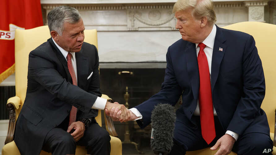 President Donald Trump meets with King Abdullah II of Jordan in the Oval Office of the White House, June 25, 2018, in Washington.