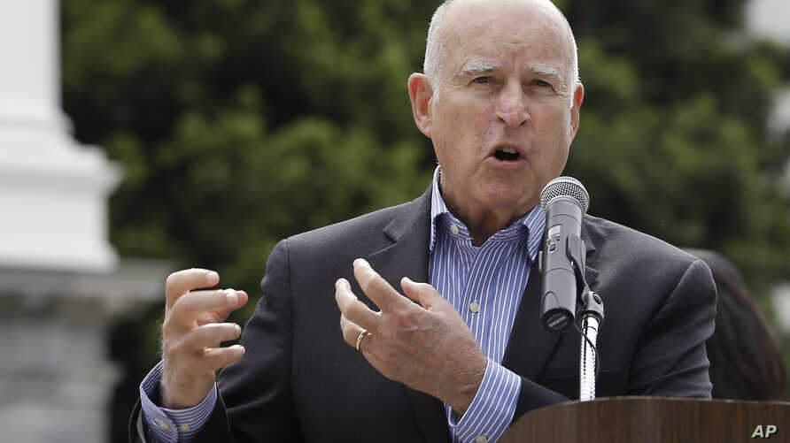 Gov. Jerry Brown addresses the crowd at a victims' rights rally, April 9, 2018, in Sacramento, Calif.