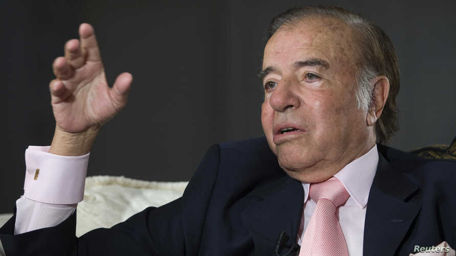 Former Argentine President  and current senator Carlos Menem, 79, speaks during an interview with Reuters at his home in Buenos Aires, Oct. 6, 2009.